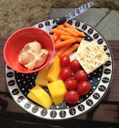 Snack: crackers, hummus, baby carrots, tomatoes, mango